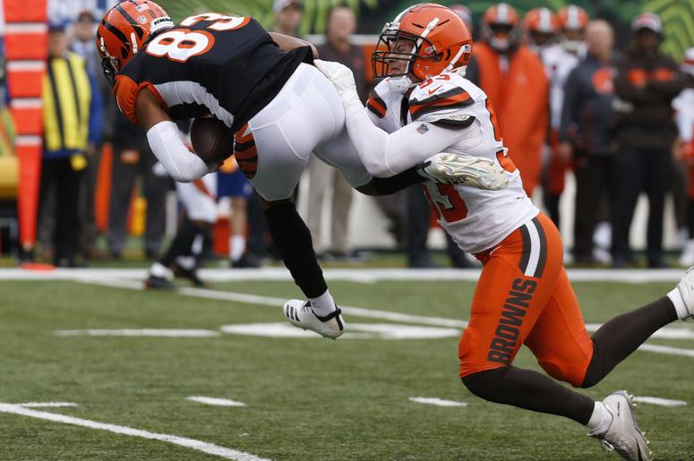 incinnati Bengals wide receiver Tyler Boyd (83) catches a pass against Cleveland Browns middle linebacker Joe Schobert (53) during the second half at Paul Brown Stadium.