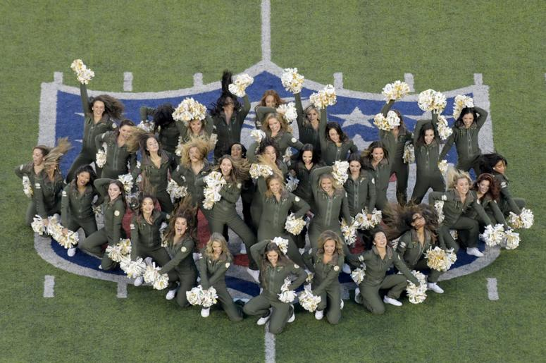 New York Jets cheerleaders perform before a game against the Houston Texans at MetLife Stadium.