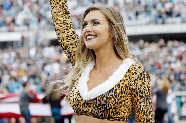 acksonville Jaguars cheerleader cheers against the Washington Redskins during the first half at TIAA Bank Field.