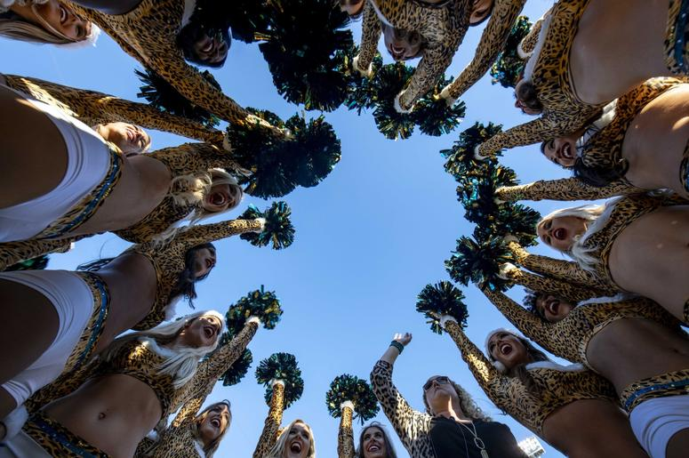 Jacksonville Jaguars cheerleaders make a final cheer in a huddle after the final home game of the season between the Jacksonville Jaguars and the Washington Redskins at TIAA Bank Field.