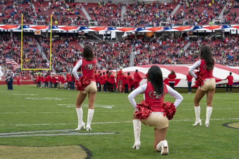 San Francisco 49ers cheerleader Kayla Morris kneels during the national anthem before the game against the Seattle Seahawks at Levi's Stadium.