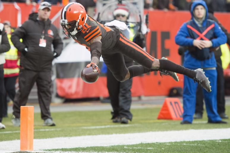 Cleveland Browns wide receiver Rashard Higgins (81) dives into the end zone for a touchdown during the second half against the Cincinnati Bengals at FirstEnergy Stadium.