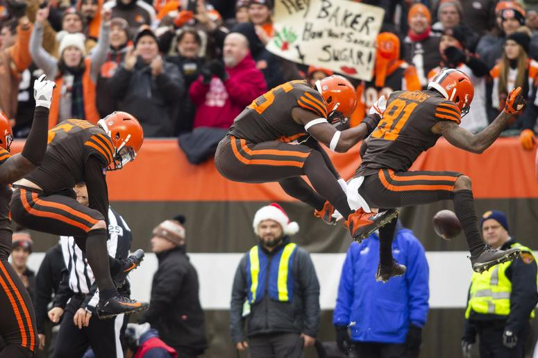Cleveland Browns quarterback Baker Mayfield (6) and wide receiver Rashard Higgins (81) celebrate a touchdown by tight end David Njoku (85) during the second quarter against the Cincinnati Bengals at FirstEnergy Stadium.
