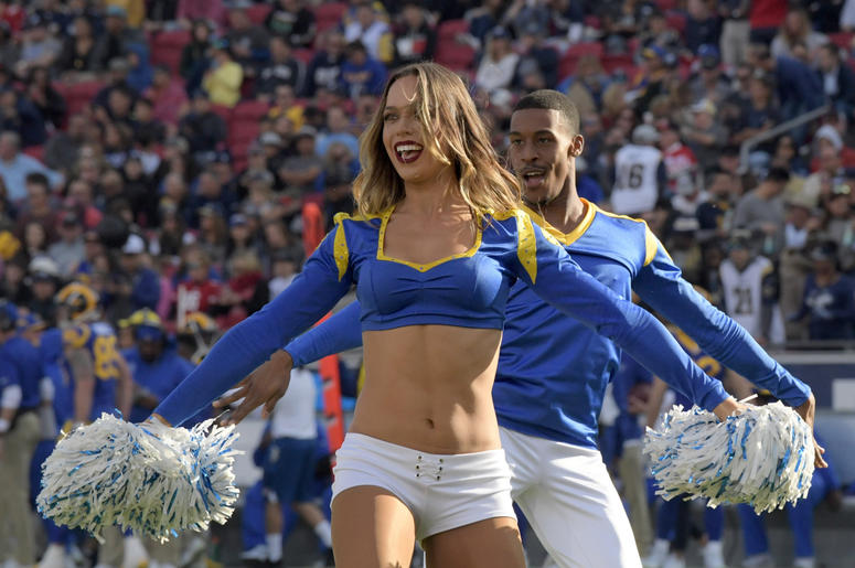 os Angeles Rams cheerleader Sydney Zmrzel (left) and Quinton Peron perform during the game against the San Francisco 49ers at Los Angeles Memorial Coliseum.