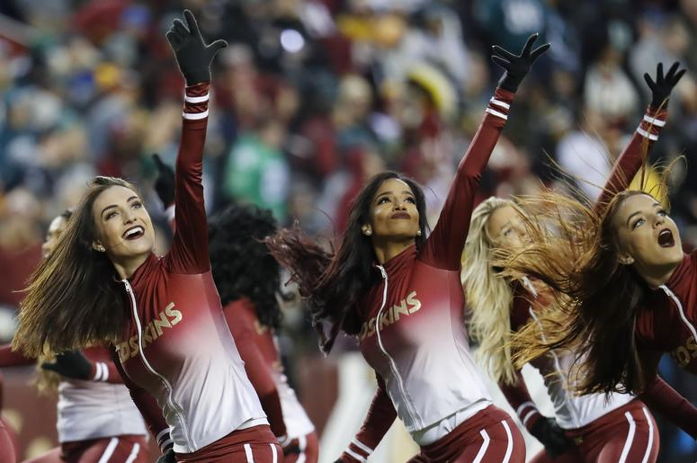 Washington Redskins cheerleaders dance on the field during a timeout against the Philadelphia Eagles in the second quarter at FedEx Field. The Eagles won 24-0.