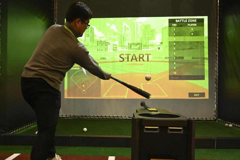 "January 8, 2019; Las Vegas, NV, USA; Seungwon Choi takes a swing Auto Bat's ""Perfection\"" a batting training and analysis product during the Consumer Electronics Show 2019 at the Sands Expo Convention Center."