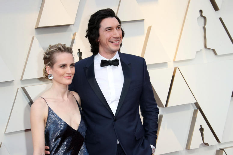 Joanne Tucker, left and Adam Driver arrive at the 91st Academy Awards at the Dolby Theatre.