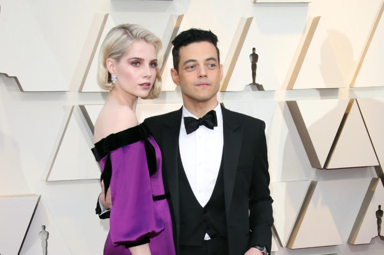 Lucy Boynton, left, and Rami Malek arrive at the 91st Academy Awards at the Dolby Theatre.