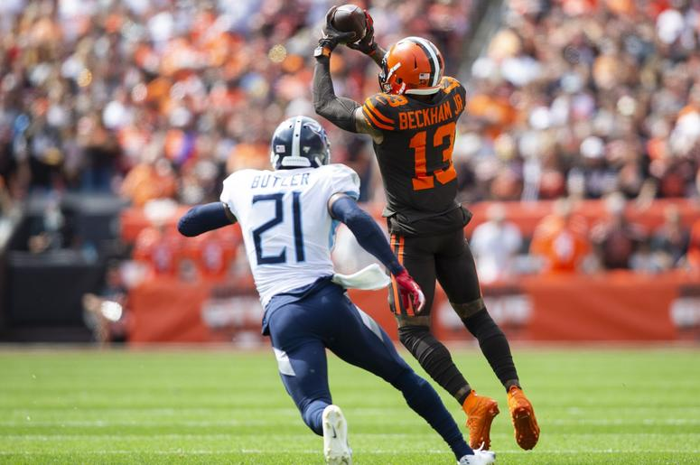 leveland Browns wide receiver Odell Beckham (13) makes a catch under coverage by Tennessee Titans cornerback Malcolm Butler (21) during the first quarter at FirstEnergy Stadium.
