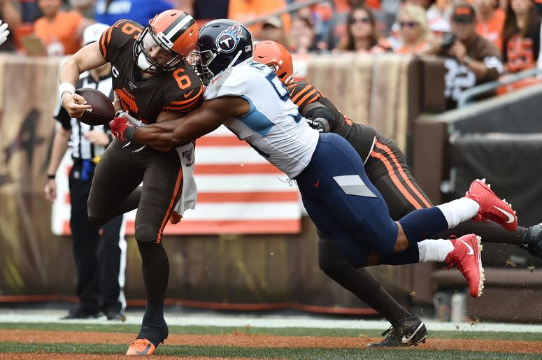 Tennessee Titans linebacker Cameron Wake (91) sacks Cleveland Browns quarterback Baker Mayfield (6) in the end zone for a safety during the first half at FirstEnergy Stadium.