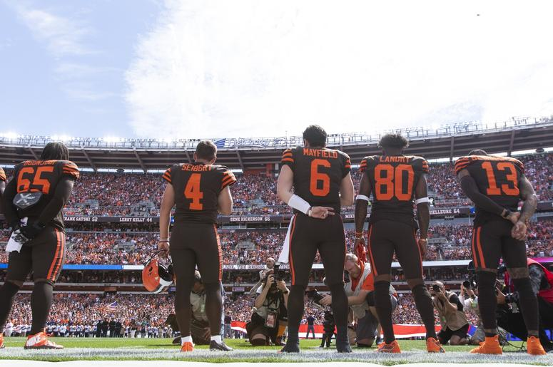he Cleveland Browns stand on the sideline during the national anthem before the game against the Tennessee Titans at FirstEnergy Stadium.