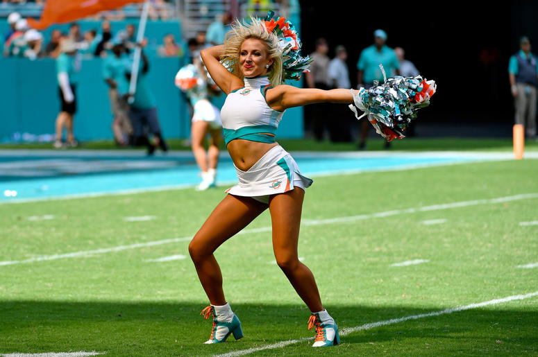 A Miami Dolphins cheerleader performs during the second half against the Baltimore Ravens at Hard Rock Stadium.