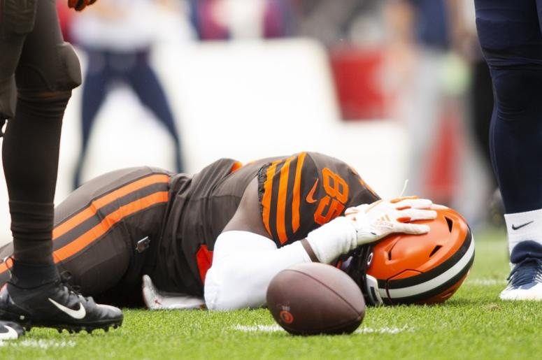 Cleveland Browns tight end David Njoku (85) lays on the ground following a hit to the head by the Tennessee Titans during the second quarter at FirstEnergy Stadium.