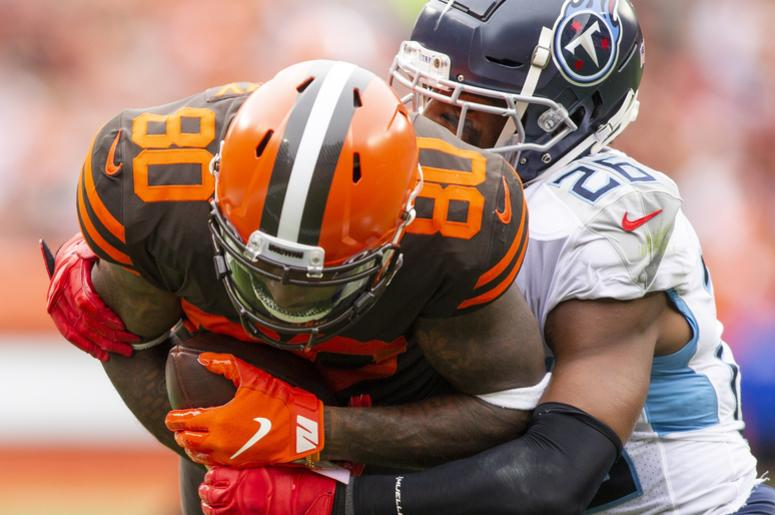 Cleveland Browns wide receiver Jarvis Landry (80) makes a catch for a first down against Tennessee Titans cornerback Logan Ryan (26) during the third quarter at FirstEnergy Stadium.