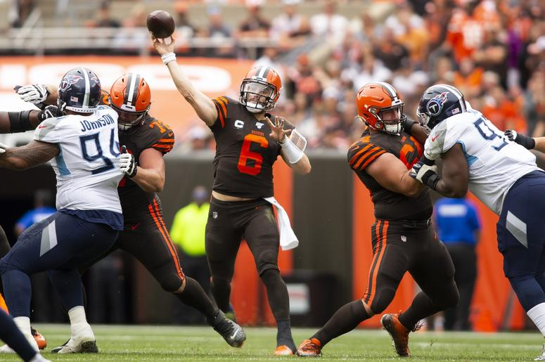 Cleveland Browns quarterback Baker Mayfield (6) throws the ball for a first down against the Tennessee Titans during the third quarter at FirstEnergy Stadium.