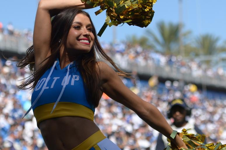 A Los Angeles Chargers cheerleader performs during the third quarter against the Indianapolis Colts at Dignity Health Sports Park.