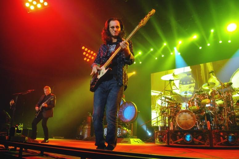 Geddy Lee (lead vocalist and bassist), Alex Lifeson (guitarist), and Neil Peart (drummer) of iconic Canadian rock band Rush