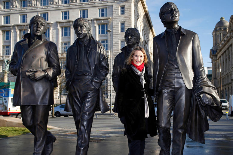 A new statue of the Beatles is unveiled by John Lennon's sister Julia Baird outside the Liverbuilding, in Liverpool.