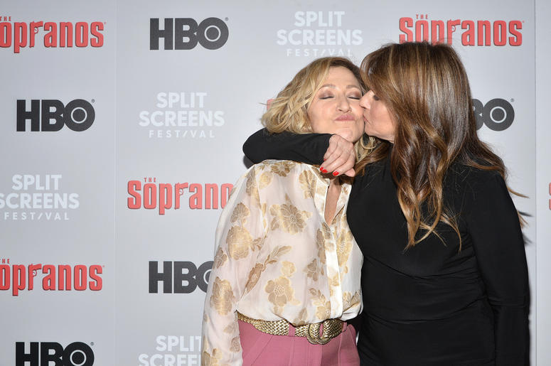 Actress Lorraine Bracco (r) kisses actress Edie Falco as they attend The Sopranos 20th Anniversary Red carpet and Panel Discussion during the Sopranos Film Festival at SVA Theatre in New York, NY, January 9, 2019.