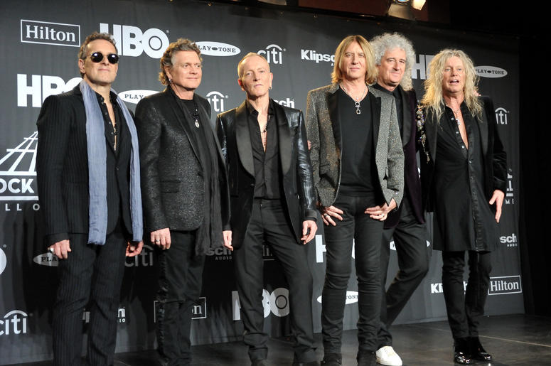 Def Leopard (L_R: Vivian Campbell, Rick Allen, Phil Collen, Joe Elliott, Brian May of Queen, and Rick Savage) in the press room at the 2019 Rock and Roll Hall of Fame Induction Ceremony at the Barclays Center in Brooklyn, NY on March 29, 2019.