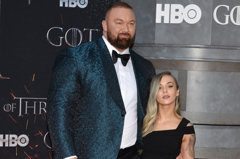 """(L-R) Hafþor Julius Bjornsson and Kelsey Henson attend HBO's """"Game of Thrones"""" eight and final season premiere at Radio City Music Hall in New York, NY, April 3, 2019."""