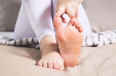 Woman Pointing To Big Toe