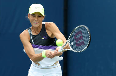 Natalia Vikhlyantseva of Russia returns a shot against Julia Goerges of Germany