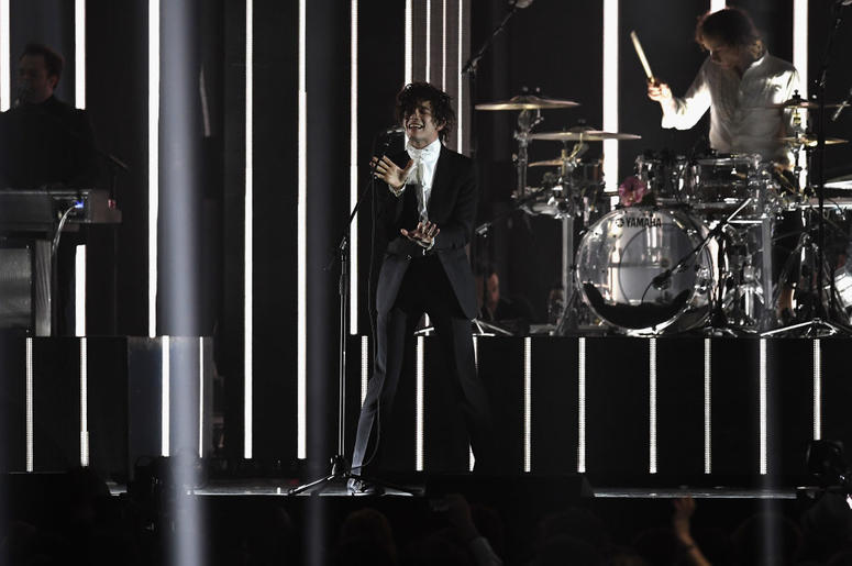 Matthew Healy performs with The 1975 on stage at The BRIT Awards 2017