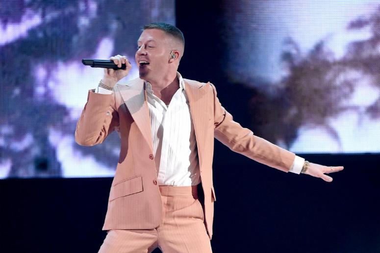 LOS ANGELES, CA - NOVEMBER 19: Macklemore performs at the 2017 American Music Awards at Microsoft Theater on November 19, 2017 in Los Angeles, California.