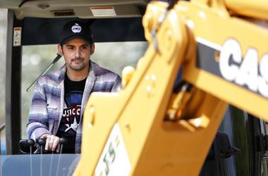 Brad Paisley operates tractor