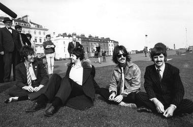 The Beatles take a break during the filming of 'The Magical Mystery Tour'