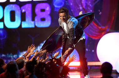 Louis Tomlinson accepts the Choice Male Artist award onstage during FOX's Teen Choice Awards at The Forum on August 12, 2018 in Inglewood, California