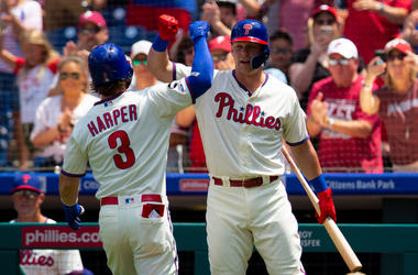 Bryce Harper #3 of the Philadelphia Phillies celebrates with Rhys Hoskins #17 after hitting a solo home run in the bottom of the first inning Atlanta Braves at Citizens Bank Park on July 28, 2019 in Philadelphia, Pennsylvania.