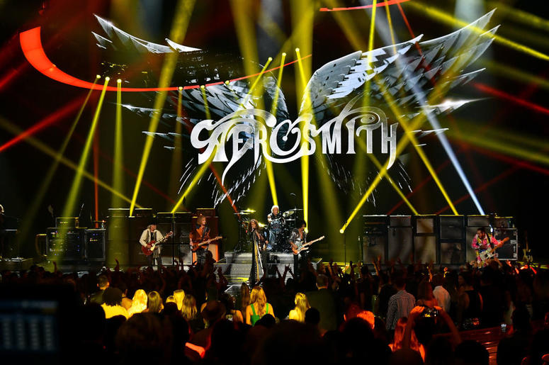 NEW YORK, NY - AUGUST 20: Aerosmith and Post Malone (R) perform onstage during the 2018 MTV Video Music Awards at Radio City Music Hall on August 20, 2018 in New York City.