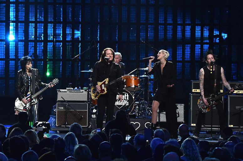 CLEVELAND, OH - APRIL 18: Inductee Joan Jett of Joan Jett and The Black Hearts (L) performs with musicians Tommy James (C) and Miley Cyrus during the 30th Annual Rock And Roll Hall Of Fame Induction Ceremony at Public Hall on April 18, 2015 in Cleveland,