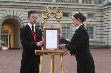 Footmen Stephen Kelly and Sarah Thompson bring out the easel in the forecourt of Buckingham Palace to formally announce the birth of a baby boy to Britain's Prince Harry and Meghan, the Duchess of Sussex, in London, Monday, May 6, 2019.