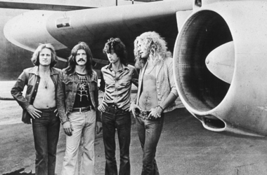 John Paul Jones, John Bonham, Jimmy Page and Robert Plant, pose in front of an their private airliner The Starship, 1973