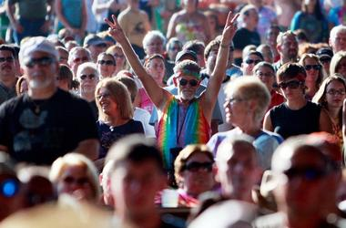 A fan flashes the peace sign during the concert marking the 40th anniversary of the Woodstock music festival August 15, 2009 in Bethel, New York