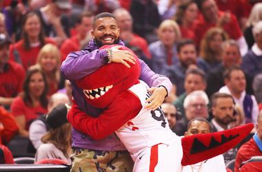 Drake hugs the Raptors mascot at the NBA Finals.