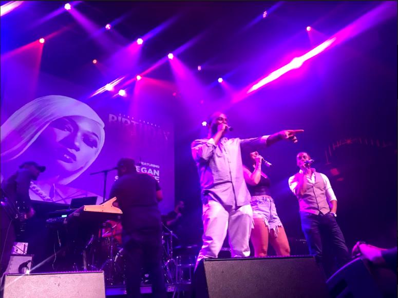Joe Clair cracks jokes on stage.