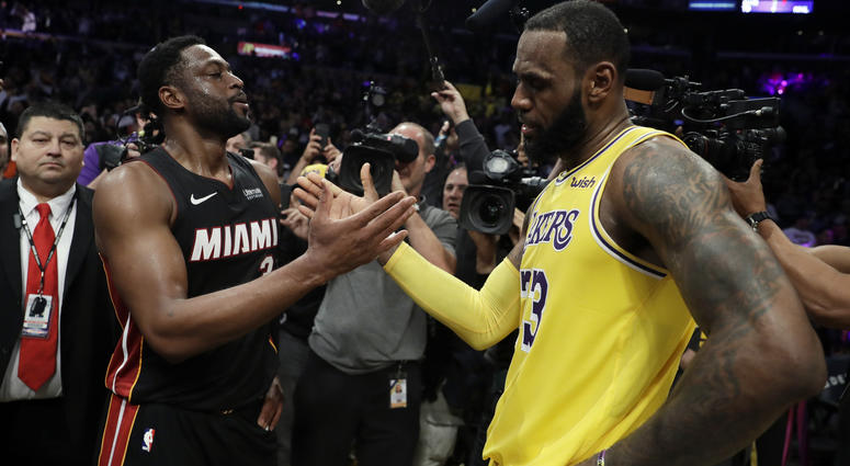 effbef9153b Miami Heat guard Dwyane Wade, left, shakes hands with Los Angeles Lakers'  LeBron James at the end of an NBA basketball game Monday, Dec.