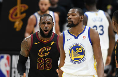 Jun 6, 2018; Cleveland, OH, USA; Cleveland Cavaliers forward LeBron James (23) reacts as Golden State Warriors forward Kevin Durant (35) looks on during the second quarter in game three of the 2018 NBA Finals at Quicken Loans Arena.