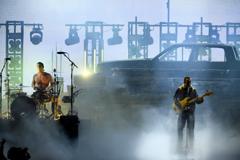 Josh Dun (L) and Tyler Joseph of Twenty One Pilots perform onstage during the 2018 American Music Awards