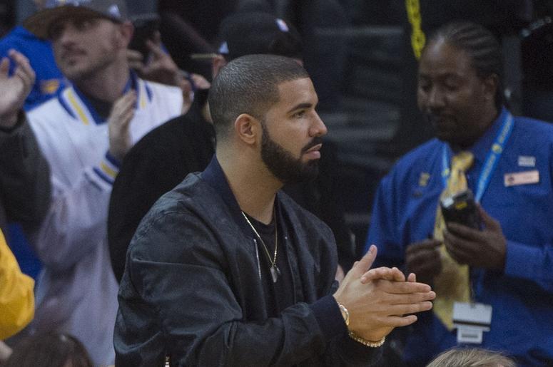 Drake hands together