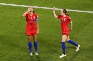 LYON, FRANCE - JULY 02: Alex Morgan of the USA celebrates with teammate Rose Lavelle after scoring her team's second goal during the 2019 FIFA Women's World Cup France Semi Final match between England and USA at Stade de Lyon on July 02, 2019 in Lyon, Fra