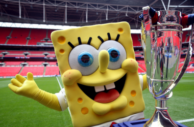 SpongeBob SquarePants with the Sky Bet League One Play Off trophy