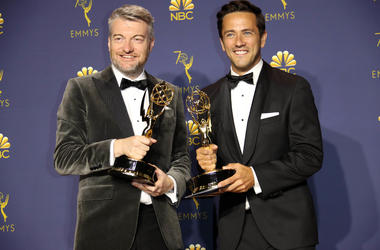 "From left, Charlie Brooker and William Bridges pose with their awards for Writing for a Limited Series, Movie or Dramatic Special for ""Black Mirror\"" in the photo room during the 70th Emmy Awards at the Microsoft Theater"
