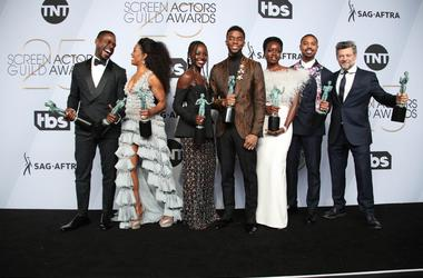 "Jan 27, 2019; Los Angeles, CA, USA; The cast of ""Black Panther\"" poses with their awards for outstanding performance by a cast in a motion picture for \""Black Panther\"" in the press room at the 25th Annual Screen Actors Guild Awards at the Shrine Auditor"