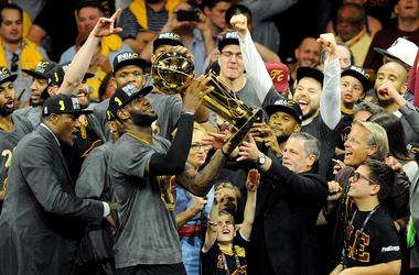 Jun 19, 2016; Oakland, CA, USA; Cleveland Cavaliers forward LeBron James (23) celebratew with the Larry O'Brien Championship Trophy after beating the Golden State Warriors in game seven of the NBA Finals at Oracle Arena