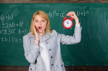 Teacher with alarm clock